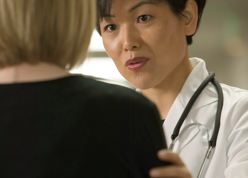 Doctor discussing the option of a medical credit card with patient.