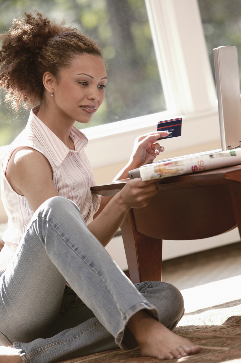 Store Credit Card: Woman Reviewing the Pros and Cons of Retail Store Credit Cards
